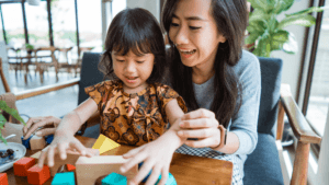 Mother and Daughter playing together to promote positive behaviour